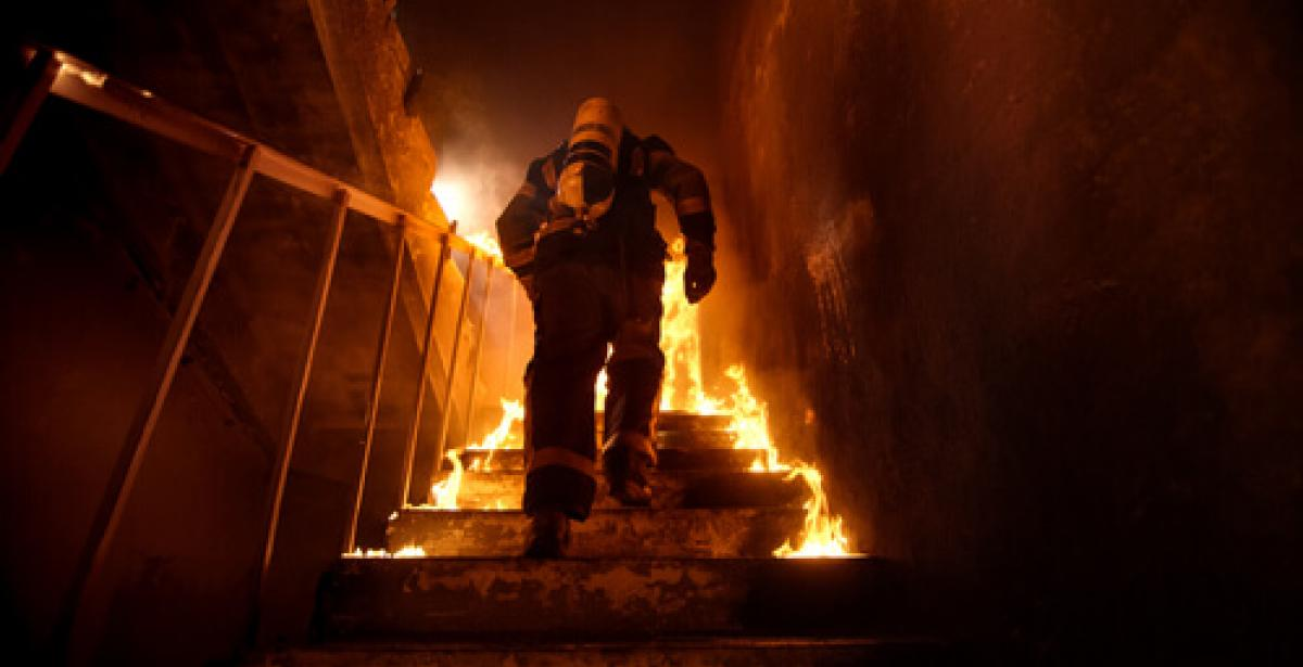 Firefighter in a Burning Building