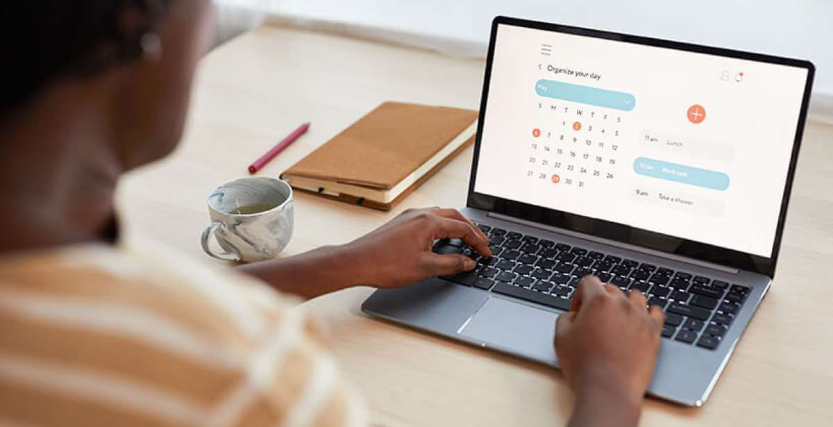 women organizing her calendar so she can study online